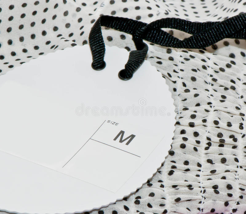 Clothes with label. Clothes with label Size M royalty free stock photo
