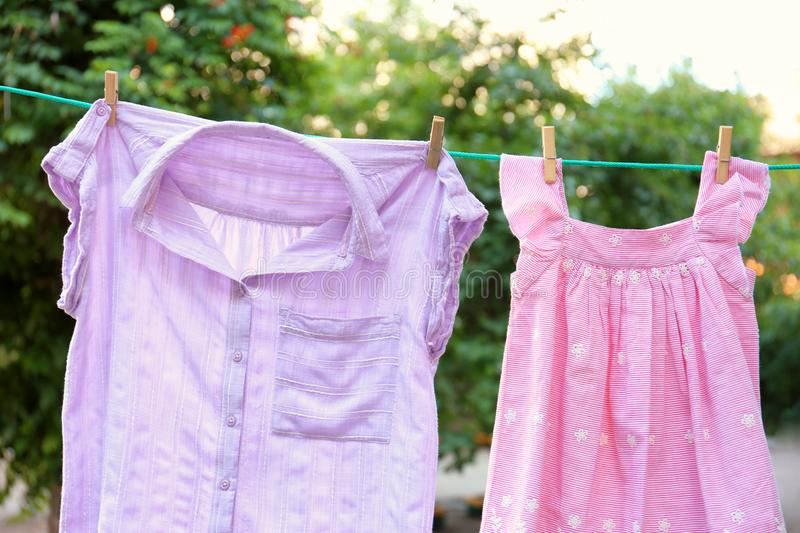 Clothes on laundry line outdoors stock image