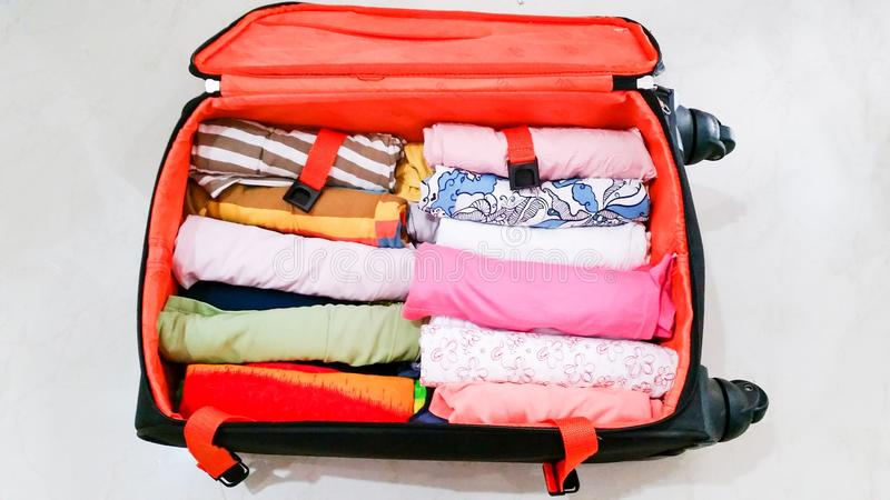 Clothes in luggage royalty free stock photos