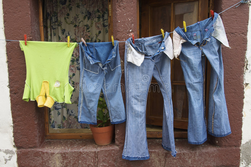 Clothes Lying In A Window In Madeira Island Royalty Free Stock Photography