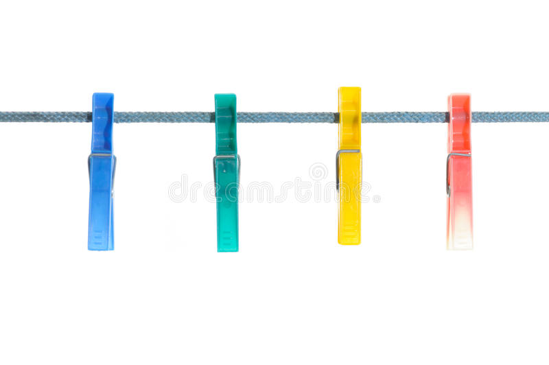 Clothes-pegs. Four colorful clothes-pegs isolated on white royalty free stock photo