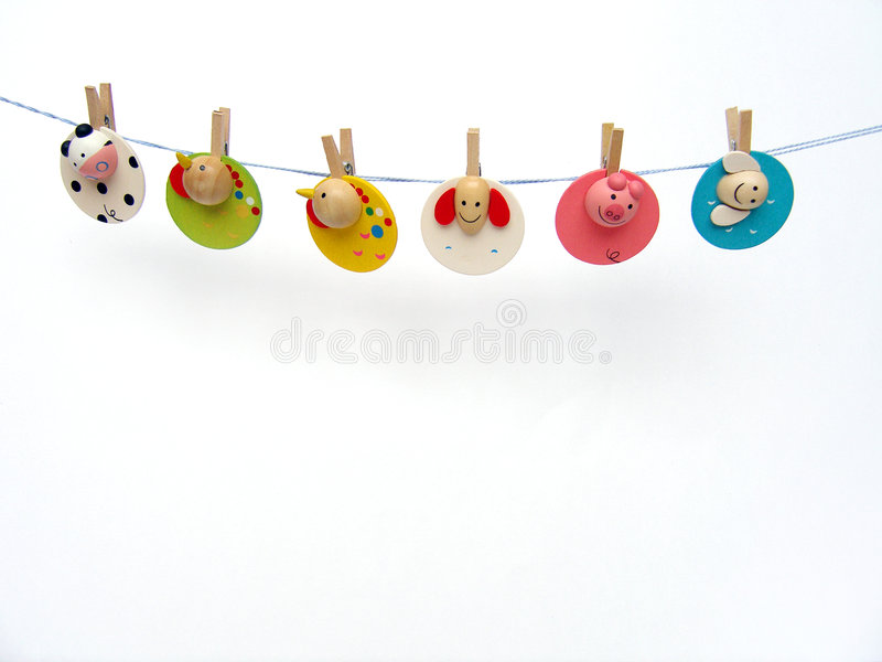 Clothes pegs on line. Happy animal friends! - A cute and colourful concept image of six fun and bright wooden paper clips, with cute design, made into clothes royalty free stock photography
