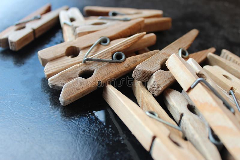 Clothes pegs after rain. Macro photography. Wooden items. Retro stock photos
