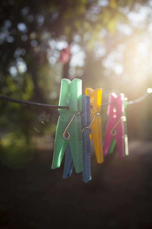 Clothes pegs on washing line stock photos