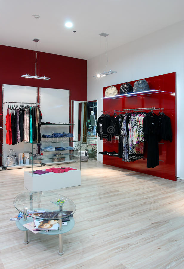 Clothes in shop. Clothes in the luxury shop royalty free stock photos