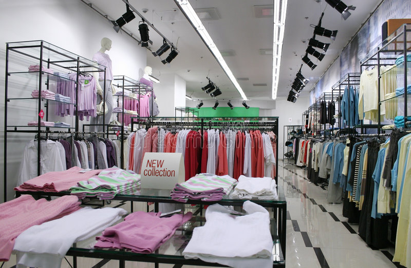 Clothes in shop stock images