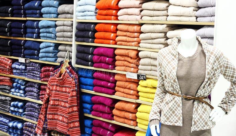 Clothes in the shop stock photos