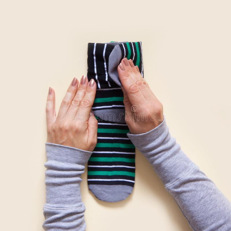 Clothes storage. Order in the closet. Folding socks. Master Class. royalty free stock photos