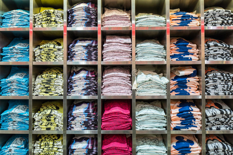 Clothes in a store. Stack in a clothes store in situation stock images