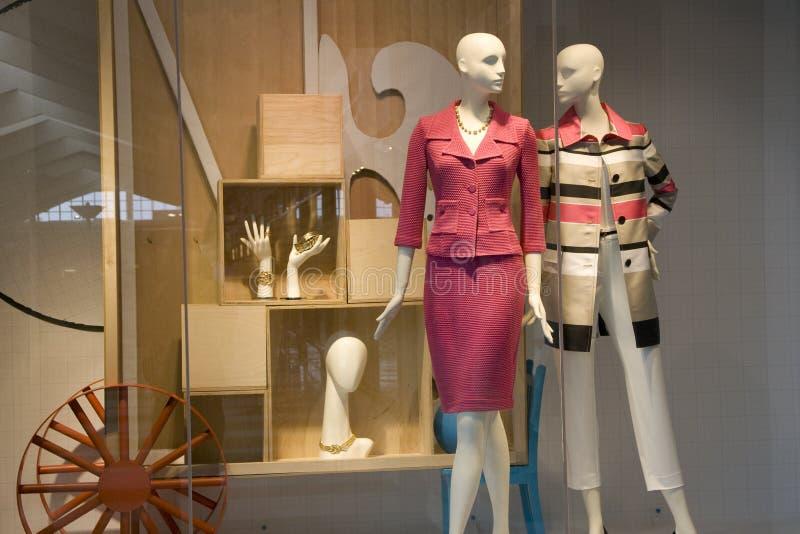 Stylish clothing fashion store window stock images