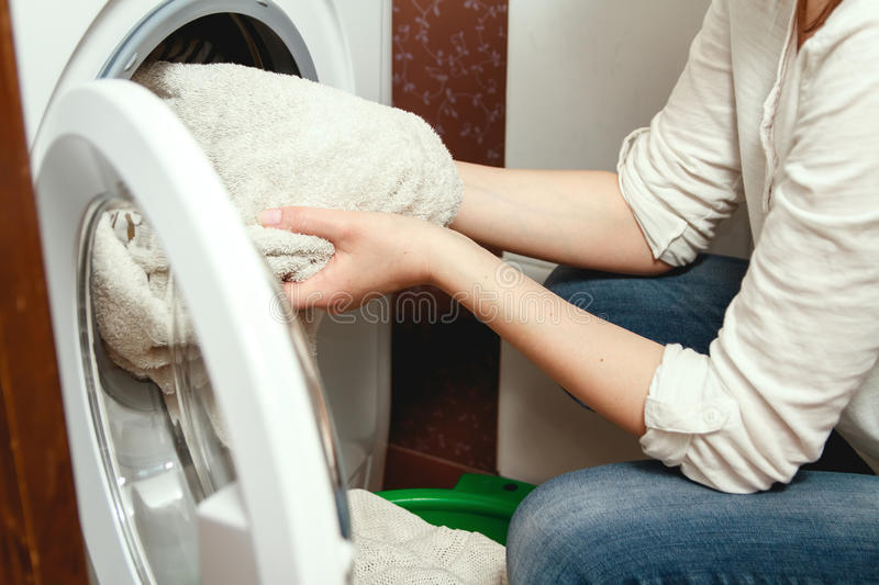 Clothes washing in the washing machine stock images