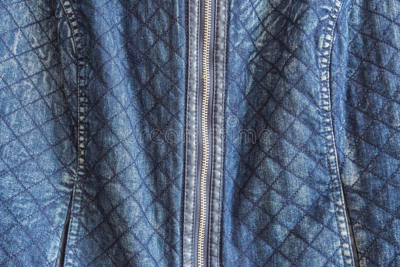Clothes, wear and fashion concept - close up of denim item or jeans zipper. Or denim jacket stock photo