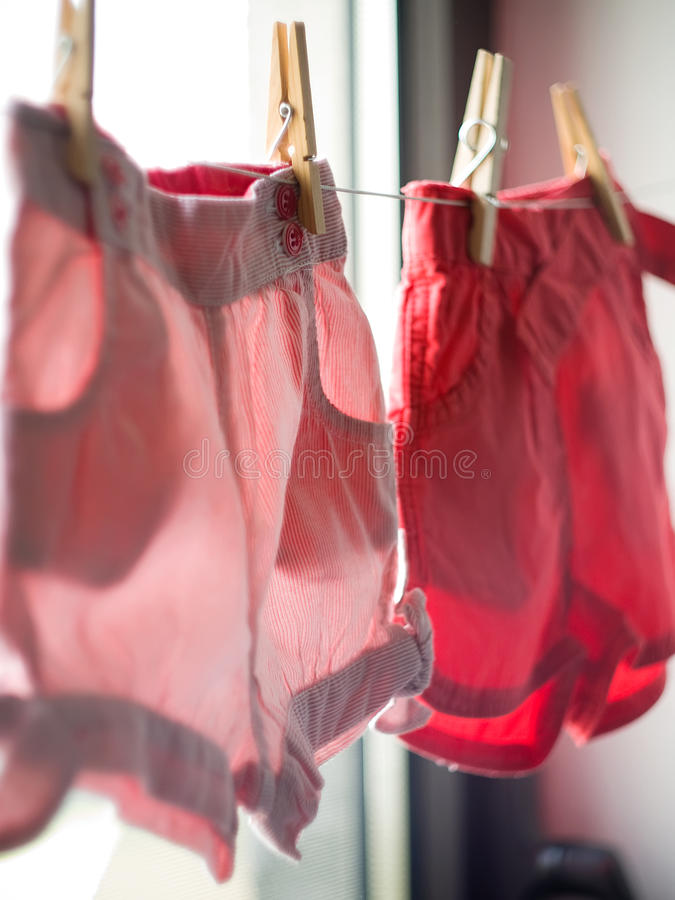 Download Clothes On The Window Shop Royalty Free Stock Photo - Image: 25059995