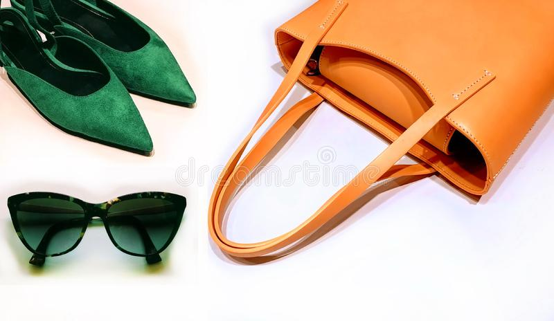 Clothes for women yellow handbag red wallet sunglass leather gloves and blue sandals fashion accessories summer spring season tre. Clothes for women yellow royalty free stock photo