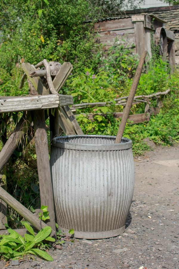 Victorian Dolly Wash Tub, old fashioned method of washing clothes. Clothes would have been soaked in the Dolly Tub and then moved about with the wooden agitator stock photography