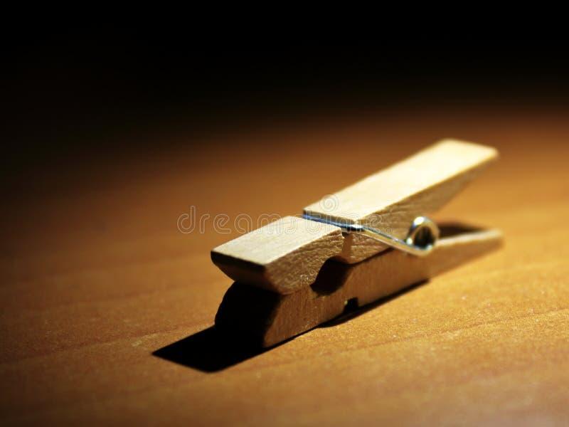 Clothespin drewniany makro- zmrok fotografia stock