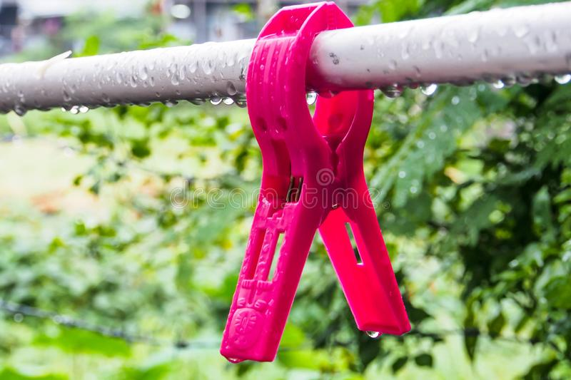 The clothespin on stainless wire stock photo