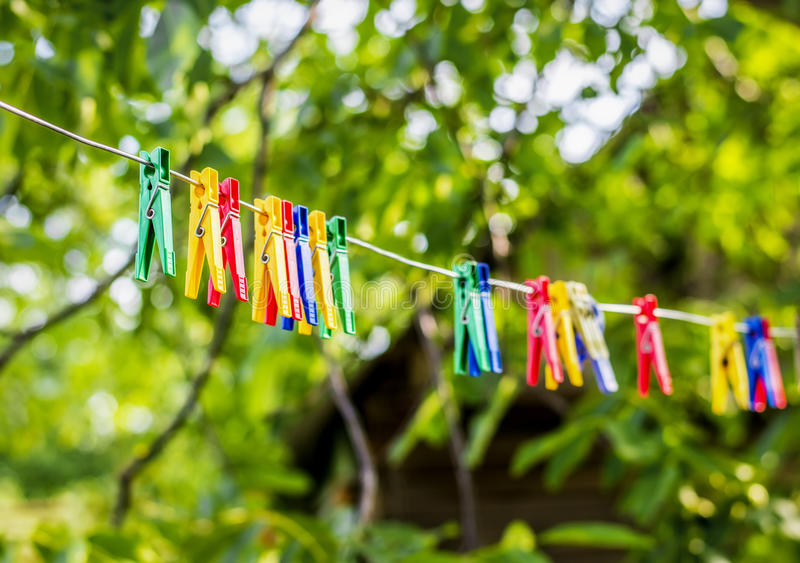 Clothespins and Clothes line on blur background.  stock photography