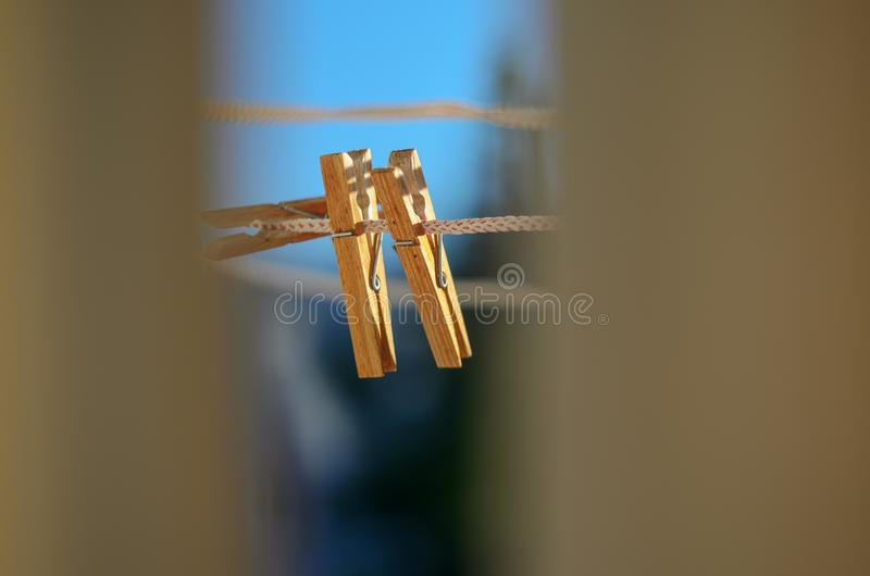 Clothespins on a clothesline against a blue sky royalty free stock photography