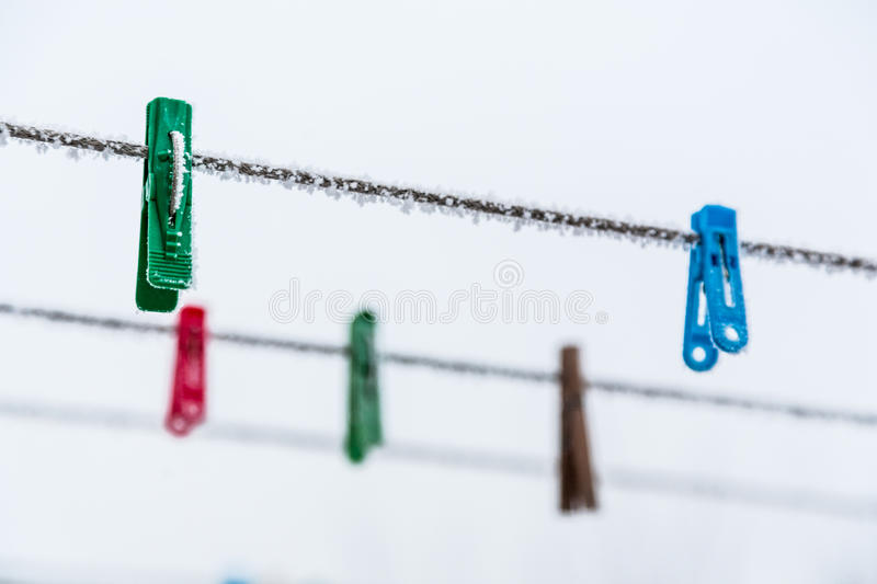 Download Clothespins On My Backyard This Winter. Stock Photo - Image: 83709892