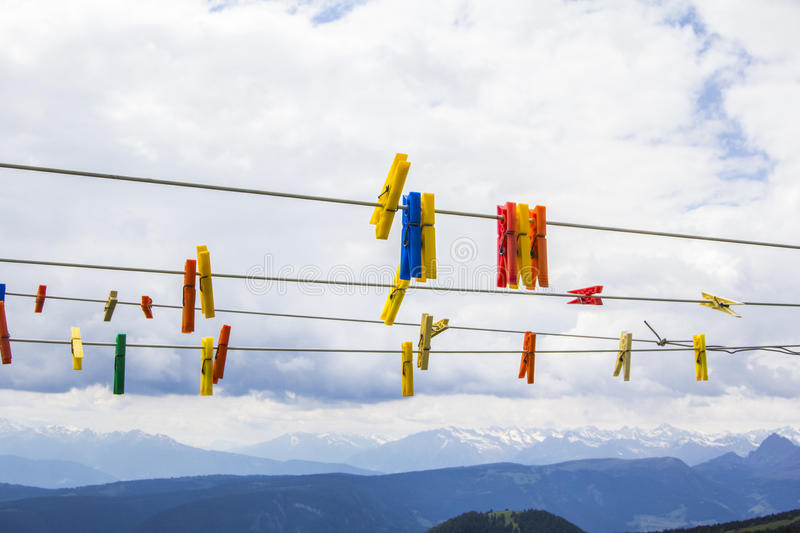 Clothespins on a rope on the background of the Dolomites stock photo