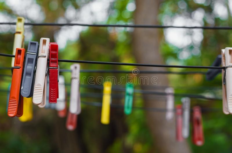 Clothespins on a rope royalty free stock image