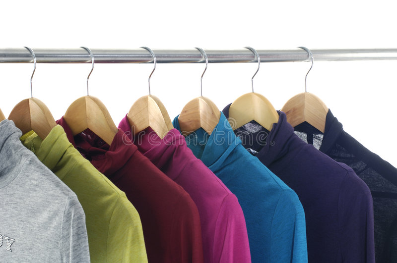 Clothing. Designer fashion clothing hanging as display stock photo