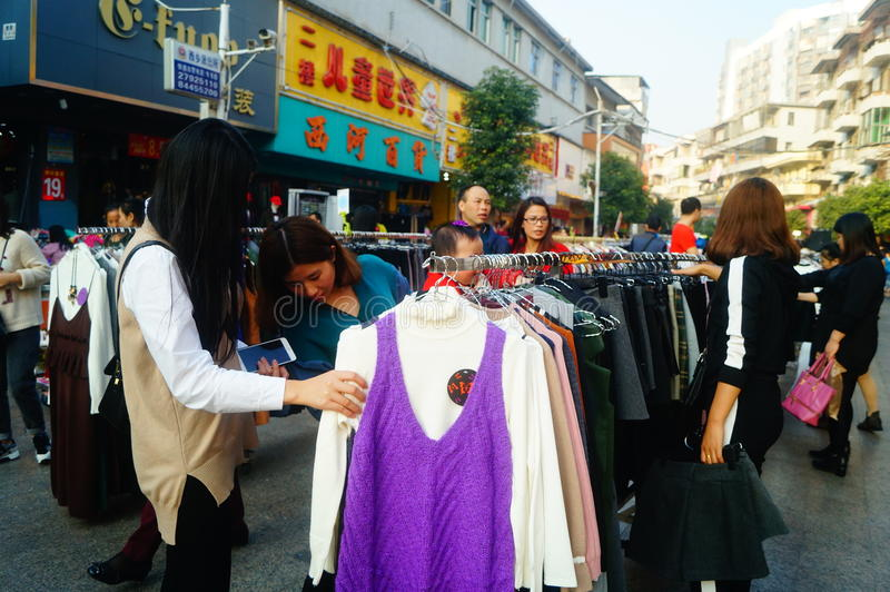 Clothing commercial street in the new year`s Day landscape, people go shopping or buy clothing royalty free stock images