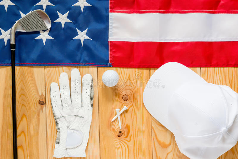 Clothing and equipment for golf. Photographed near the American flag royalty free stock images