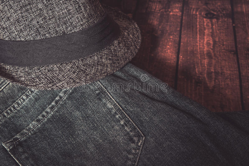 Clothing and fashion accessories on wooden table. Close-up of Clothing and fashion accessories on wooden table stock photos