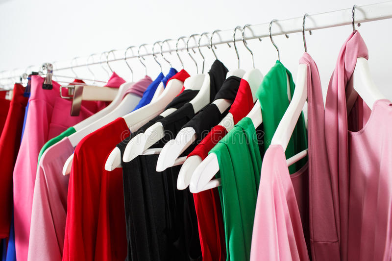 Clothing on hanger at the modern shop boutique royalty free stock photography