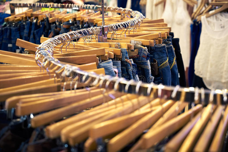 Clothing and retail store-view of shop with jeans.tif. Clothing and retail store: view of clothes shop with jeans hanged on stand stock image