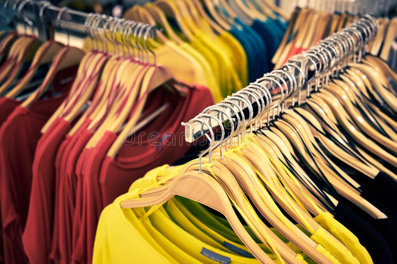 Clothing and retail store-view of shop with t-shirt. Clothing and retail store: view of clothes shop with t-shirt hanged on stand royalty free stock image