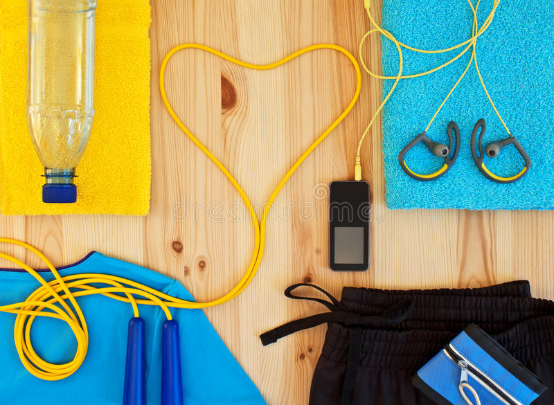 Clothing and sports accessories for fitness. Sportswear and player with headphones. Clothing and sports accessories for fitness stock image