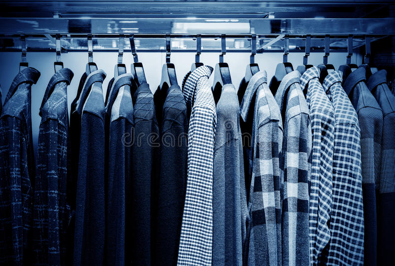 Clothing store. Mens plaid shirts on hangers in a retail store royalty free stock photo