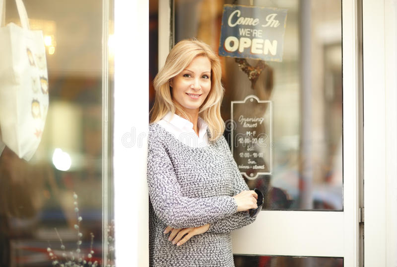 Clothing store owner businesswoman stock images