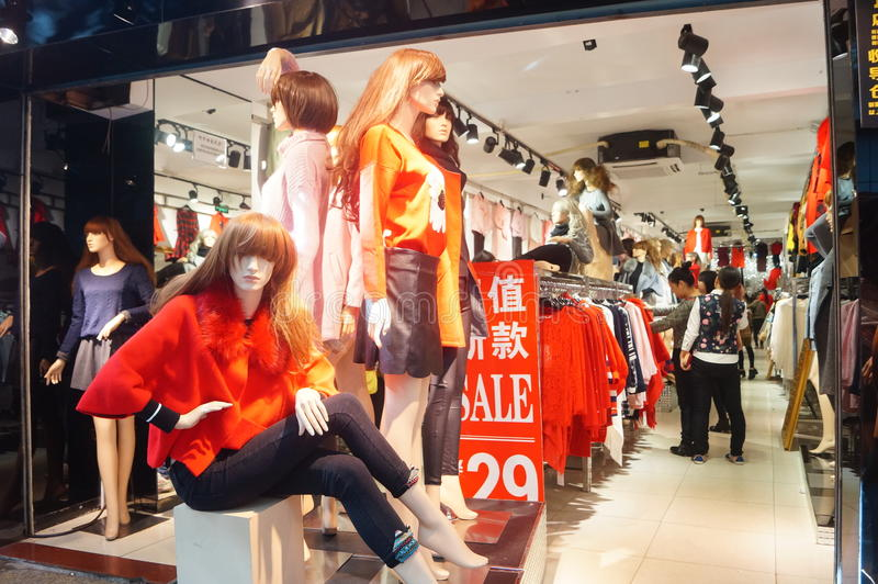 Clothing store plastic models. Plastic models clothing store in Shenzhen Xixiang Commercial Street, China royalty free stock photography