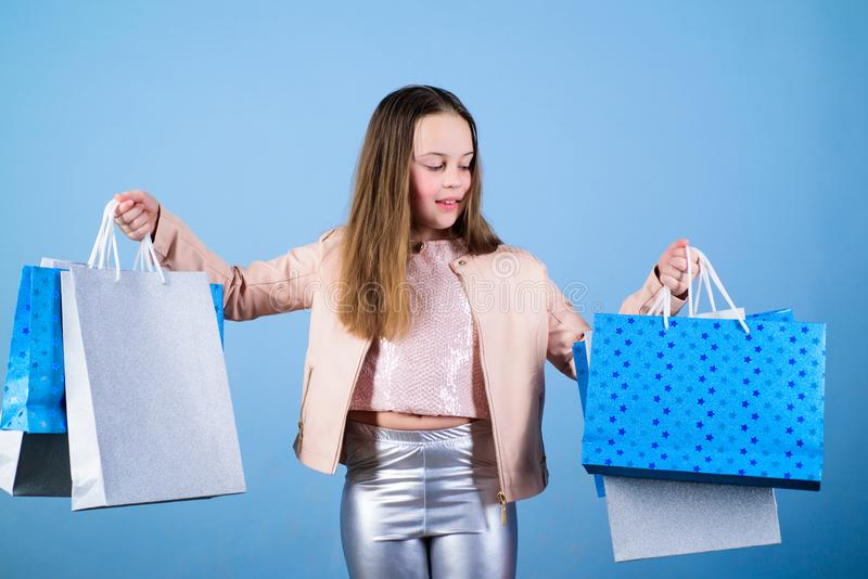 Clothing store. Sales and discounts. Holiday purchase saving. Small girl with shopping bags. Kid fashion. shop assistant stock photography