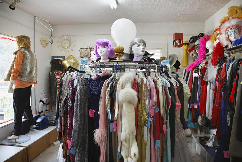 Clothing And Wigs At Second Hand Store. View of clothing and wigs in a crowded second hand store royalty free stock photos