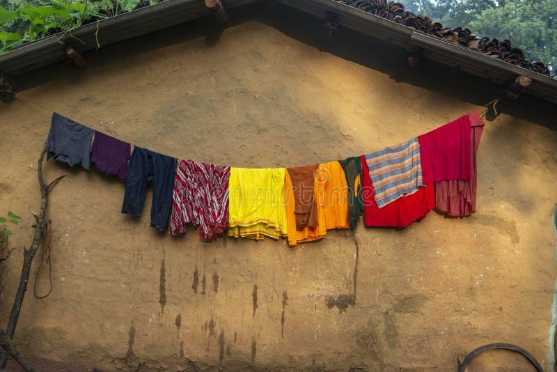 Cloths drying outside house in Nangur Village near Jagdalpur,Chhattisgarh,India. Asia stock photos