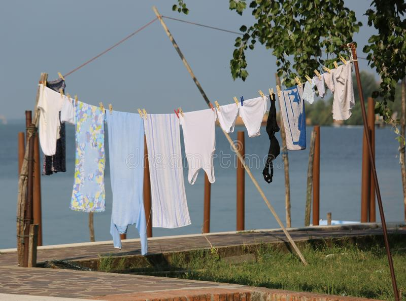 Cloths hung out to dry outdoors. Wet cloths hung out to dry outdoors stock photo
