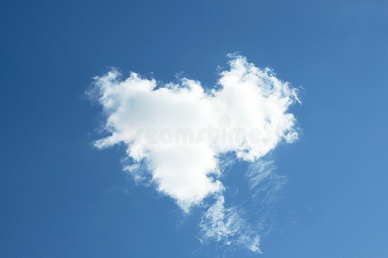 A cloud. A single cloud in the blue sky, a cloud royalty free stock photos