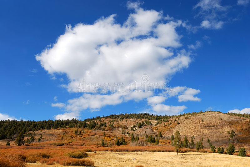 Cloud Above a Mountain royalty free stock photography