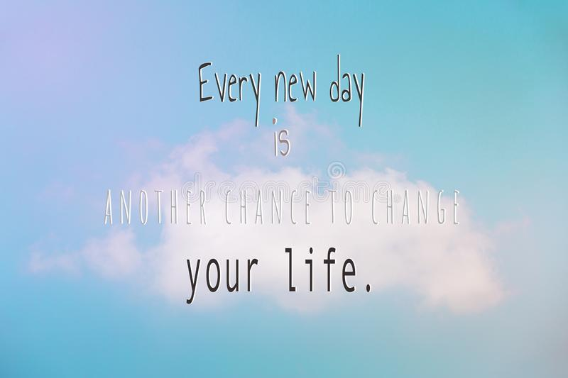 """Cloud Against The Blue Sky with word """"Every new day is another chance to change your life.  stock photography"""