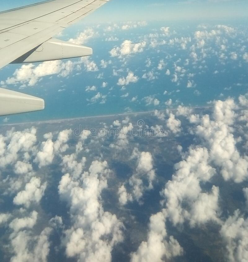 Cloud in blue sky. Aerial view. Cloud and sky view from plane. Clouds. Sky. Space. Travel. Vacation. Earth. Airplane. Background. royalty free stock photos