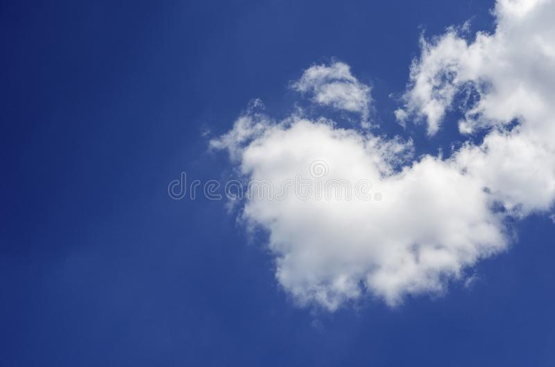 Cloud on a blue sky in the shape of a heart royalty free stock photo