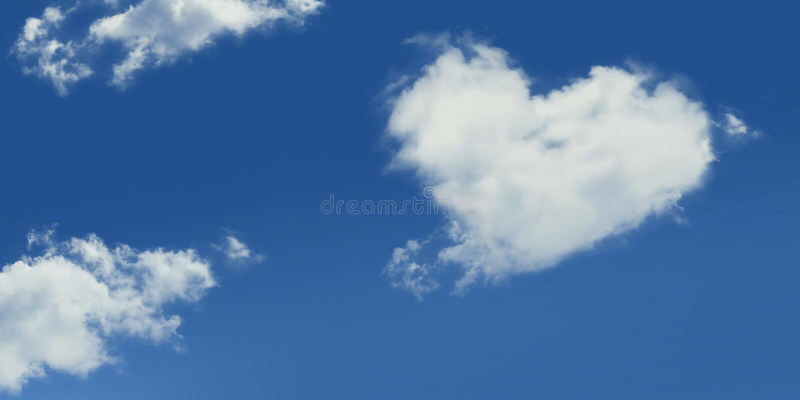 A Cloud On A Blue Sky In The Shape Of A Heart Among Other White