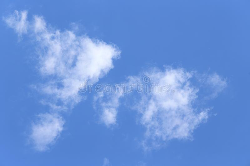 A cloud in the blue sky. Small clouds, sunny weather stock photography
