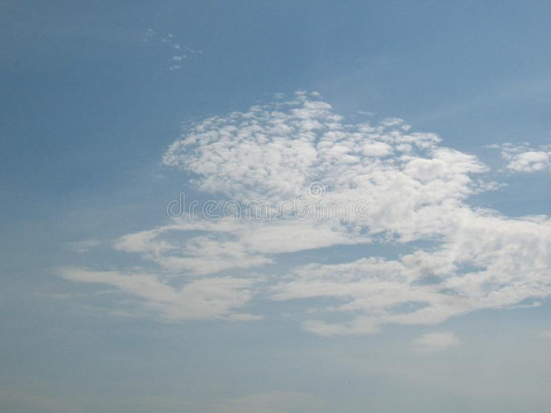 The small cloud in the blue sky. The cloud in the blue sky. In the summer season, Thailand. Clear weather stock photos