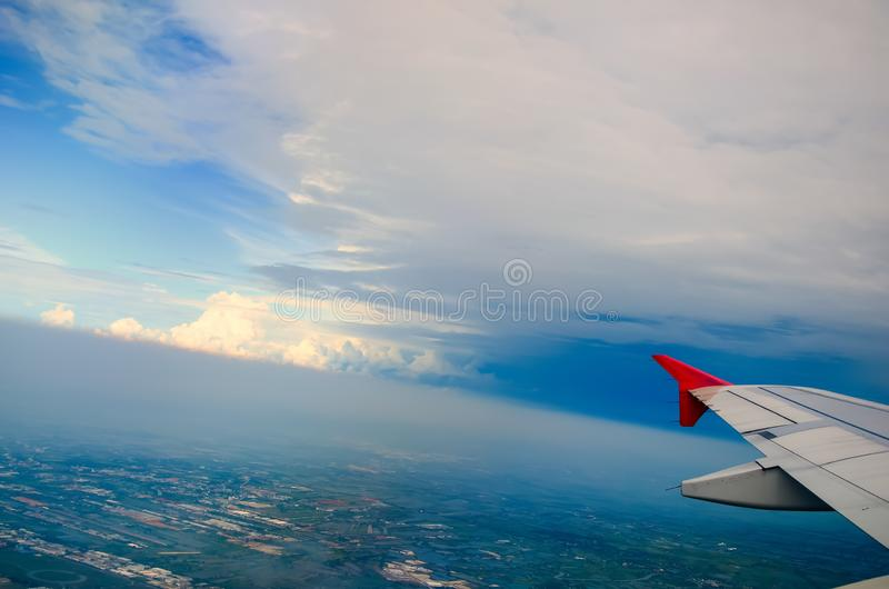 Cloud blue sky view aircraft wing airplane window stock photos